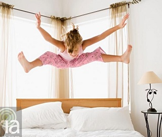 girl-jumping-on-bed-myria